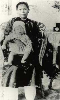 Cardinal Thuan's mother carrying him in her arms when he was a baby